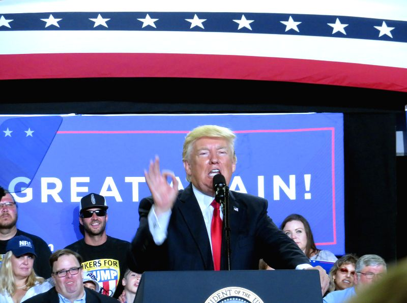 HARRISBURG, April 30, 2017 - U.S. President Donald Trump (Front) delivers a speech during a rally marking his first 100 days in office in Harrisburg, Pennsylvania, the United States, April 29, 2017. ...