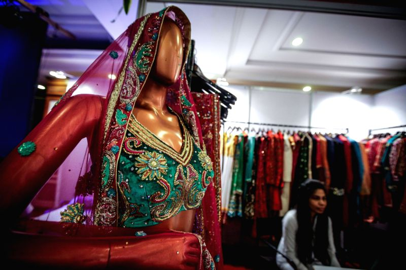 Wedding costumes are presented during the Big Fat Wedding exhibition in Gurgon of Haryana, India, Aug. 29, 2013. More than 30 exhibitors in India attended the .