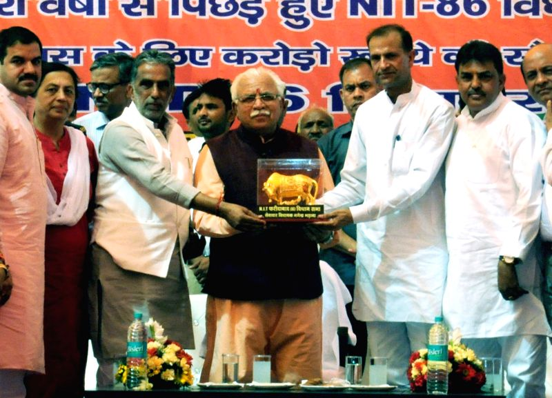 Haryana Chief Minister Manohar Lal Khattar being presented with a memento during a programme organised in Faridabad district of Haryana on April 24, 2017. - Manohar Lal Khattar