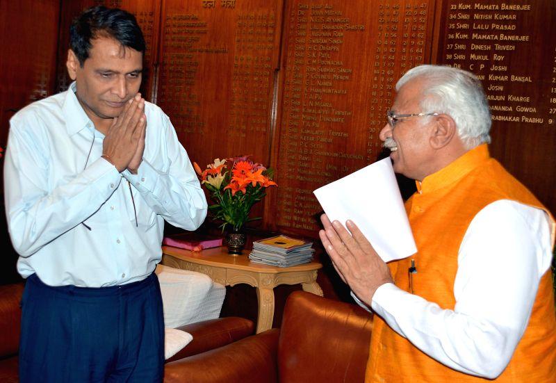 Haryana Chief Minister Manohar Lal Khattar calls on Union Minister for Railways Suresh Prabhakar Prabhu  in New Delhi, on March 27, 2015. - Manohar Lal Khattar and Suresh Prabhakar Prabhu