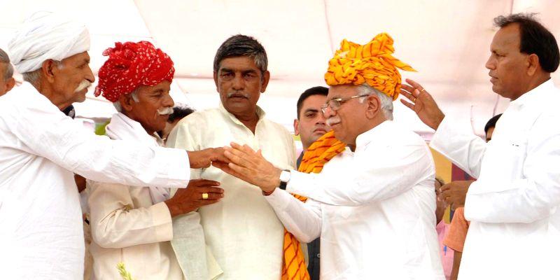 Haryana Chief Minister Manohar Lal Khattar during a public meeting at Bawal in Rewari district of Haryana on July 4, 2015. - Manohar Lal Khattar