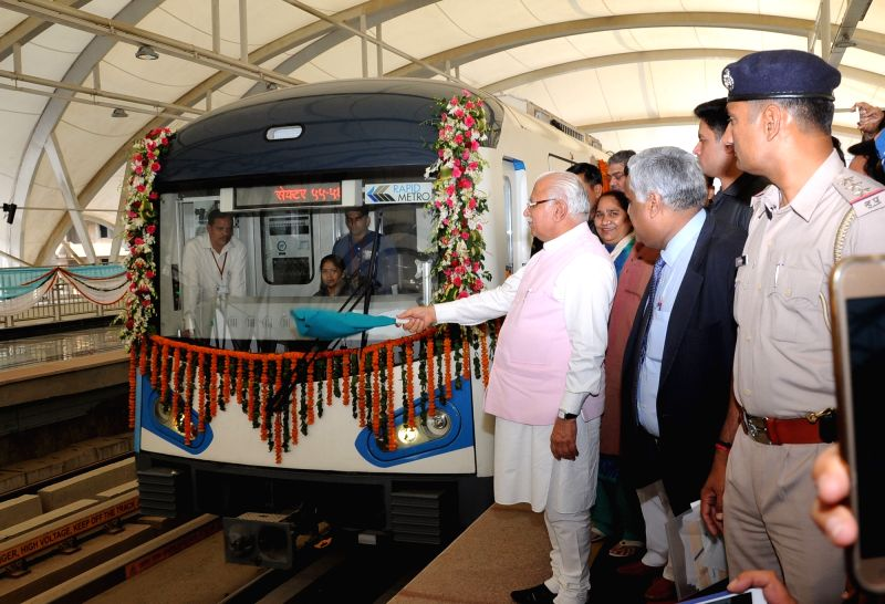 Haryana Chief Minister Manohar Lal Khattar flags of a train during inauguration of Gurgaon South Extension Line  of Rapid Metro in Gurugram on May 2, 2017. - Manohar Lal Khattar