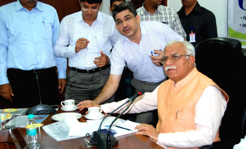 Haryana Chief Minister Manohar Lal Khattar launch online admissions in Industrial Training Institutes on concluding day of Digital India Week programme in Chandigarh on July 7, 2015. - Manohar Lal Khattar