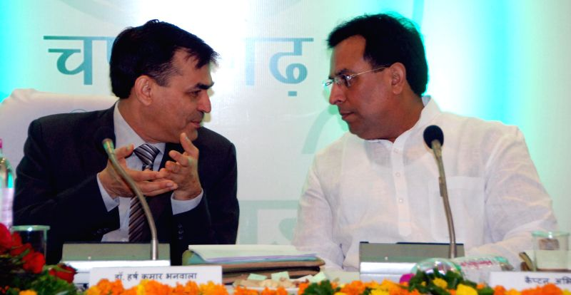 Haryana Finance Minister Capt Abhimanyu with National Bank for Agriculture interacts with Rural Development (NABARD) chairman Harsh Kumar Bhanwala during a workshop on Climate Change ... - Capt Abhimanyu and Kumar Bhanwala