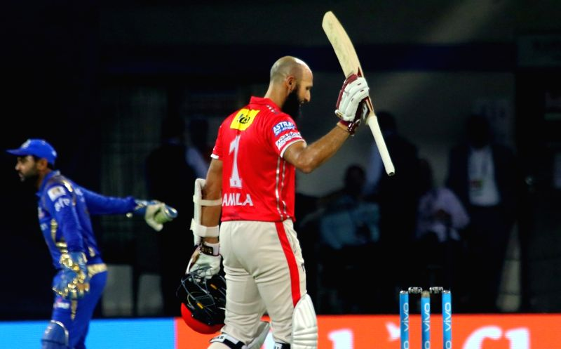 Hashim Amla of Kings XI Punjab celebrates his century during an IPL 2017 match between Kings XI Punjab and Mumbai Indians at Holkar Cricket Stadium in Indore on April 20, 2017.