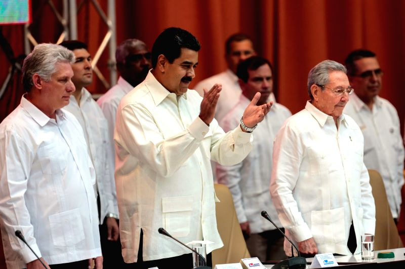 HAVANA, April 11, 2017 - Image provided by Venezuela's Presidency shows Cuban President Raul Castro (R, front) and his Venezuelan counterpart Nicolas Maduro (C, front) attending the 15th Political ...