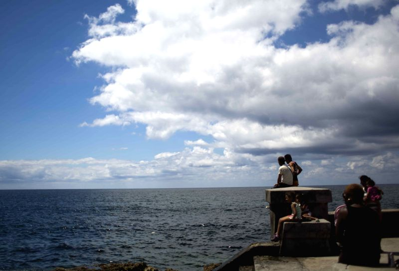 A man looks on at a pier in Havana, capital of Cuba, on April 21, 2014.