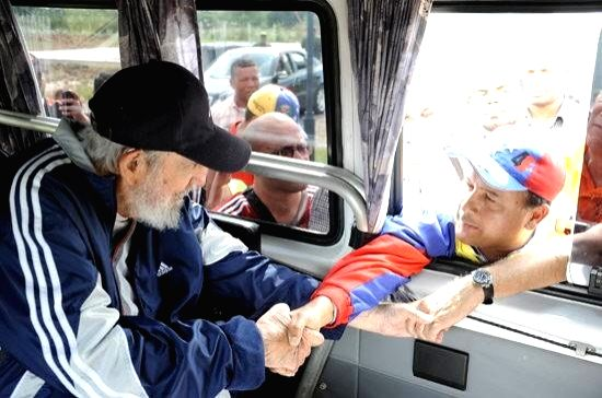 Image taken on March 30, 2015 provided by Cubadebate shows the leader of Cuban Revolution, Fidel Castro (L), greeting a person during a meeting with a group of ...