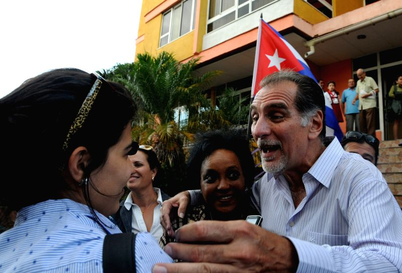 "Rene Gonzalez (R), a member of the so-called group of ""The Five"" Cubans, celebrates the return of his three partners, in Havana, Cuba, on Dec. 17, 2014. ..."