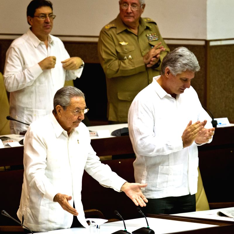 Cuban leader Raul Castro (L) gestures at the closing of the twice-yearly meeting of the National Assembly in Havana, Cuba, Dec. 20, 2014. Cuban leader Raul Castro ...