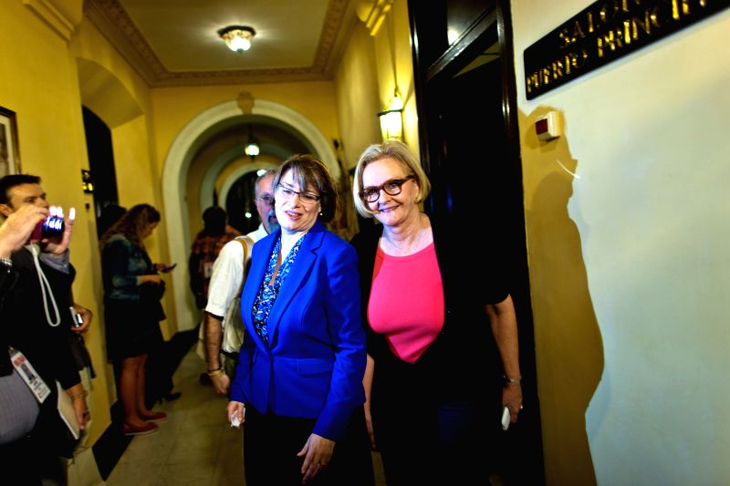 U.S. senator Amy Klobuchar (L) and senator Claire McCaskill step out of a press conference in the National Hotel of Cuba in Havana, Feb. 17, 2015. Members of a ...