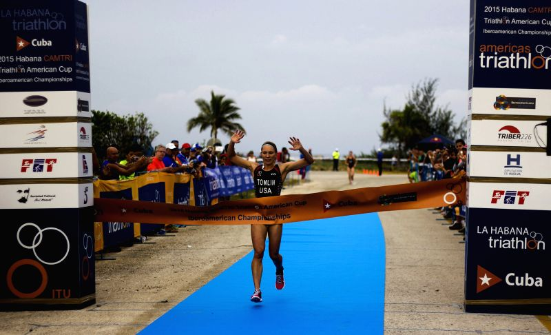 Renee Tomlin of the United States crosses the finish line at the Ibero-American Triathlon Cup in Havana, Cuba, on Jan. 24, 2015. The Ibero-American Triathlon Cup ...