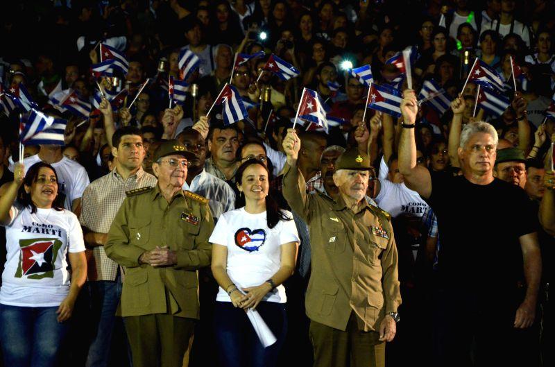 "HAVANA, Jan. 28, 2017 - Photo taken on Jan. 27, 2017 shows Cuban President Raul Castro (2nd L, Front) taking part in the ""March of Torches"" in Havana, Cuba. Cuban President Raul Castro on ..."