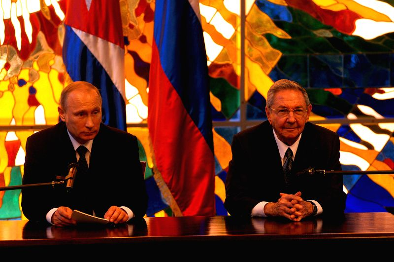 Cuban President Raul Castro (R) and his Russian counterpart Vladimir Putin attend a joint press conference in Havana city, Cuba, on July 11, 2014. Vladimir Putin ...