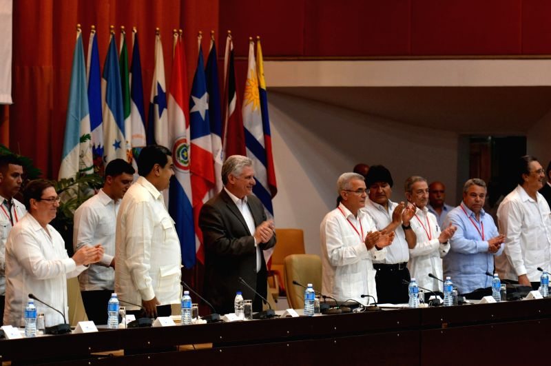 HAVANA, July 18, 2018 - Cuban President Miguel Diaz-Canel (3rd L, front), Venezuelan President Nicolas Maduro (2nd L, front) and Bolivian President Evo Morales (4th R, front) react during the final ...