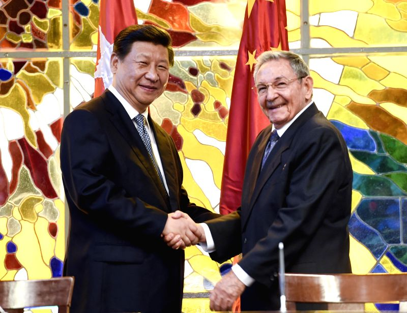 Chinese President Xi Jinping (L) and Cuban President Raul Castro attend a signing ceremony for bilateral documents in Havana, capital of Cuba, July 22, 2014. ...