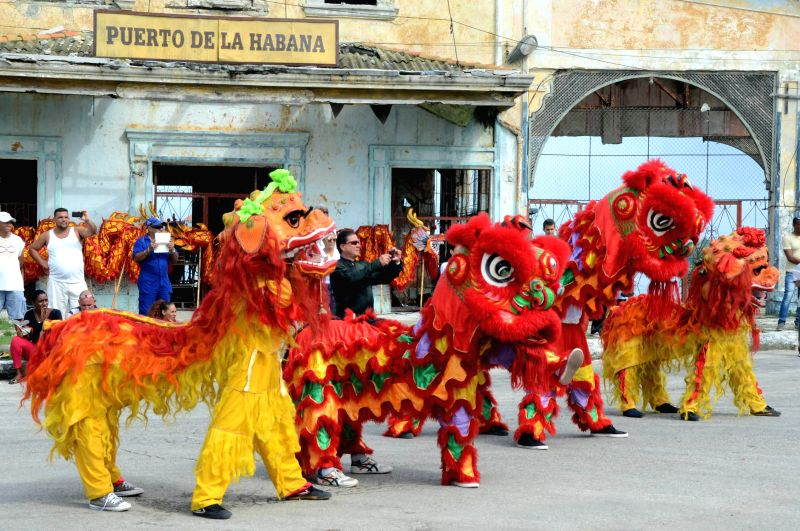 HAVANA, June 4, 2017 - Members of the Cuban School of Wushu perform lion dance during a political-cultural event held to mark the 170th anniversary of Chinese presence in Cuba in Regla, Cuba, June 3, ...