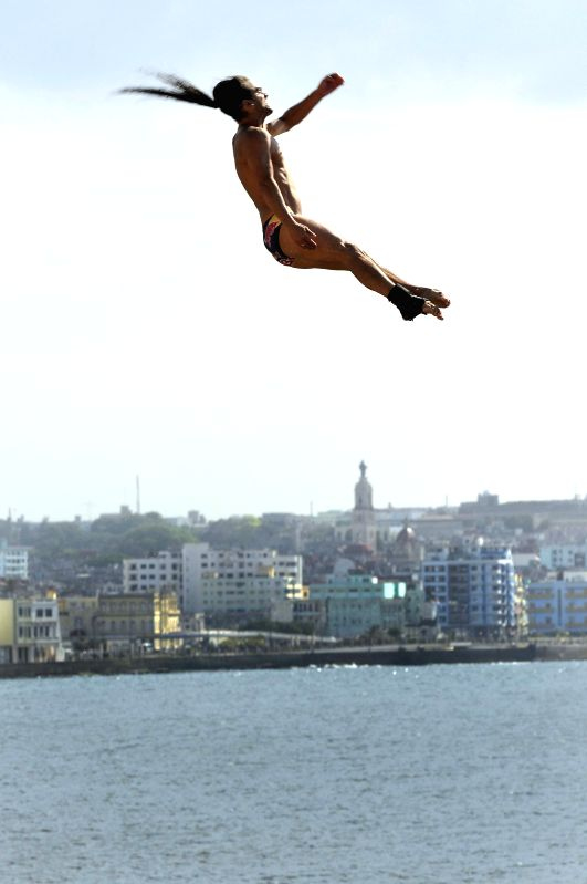 A diver competes during the sixth season of the Cliff Diving World Series, in Havana, Cuba, on May 10, 2014.