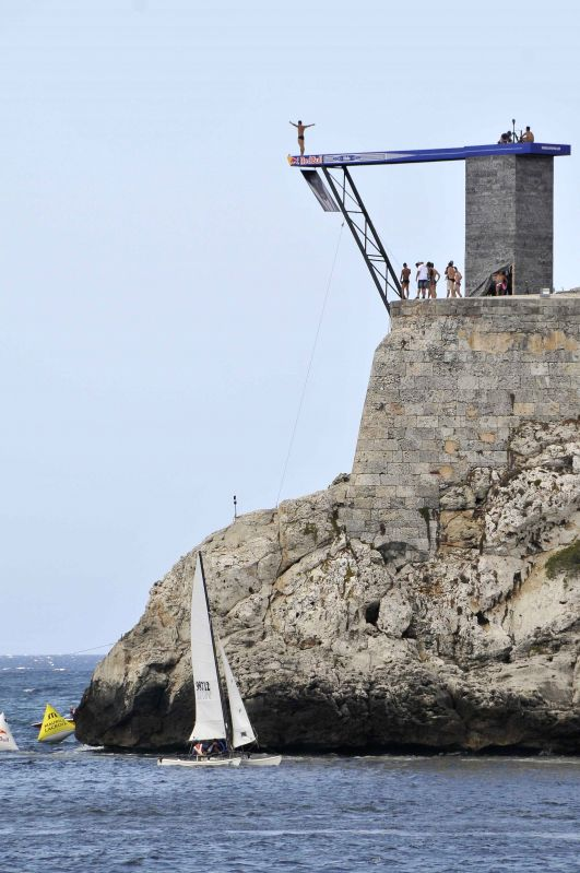 Divers compete during the sixth season of the Cliff Diving World Series, in Havana, Cuba, on May 10, 2014.