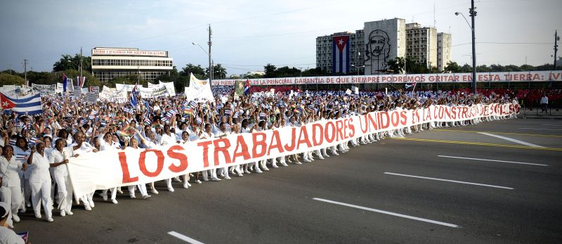 People march to  Revolution Square during the International Labor Day parade, in Havana, capital of Cuba, on May 1, 2014. Photo: