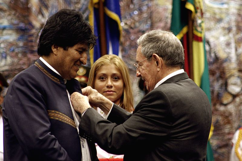 HAVANA, May 21, 2016 - Cuba's President Raul Castro (R) decorates Bolivia's President Evo Morales (L) with the Jose Marti Order in the Revolution Palace in Havana, Cuba, on May 20, 2016. Cuban leader ...