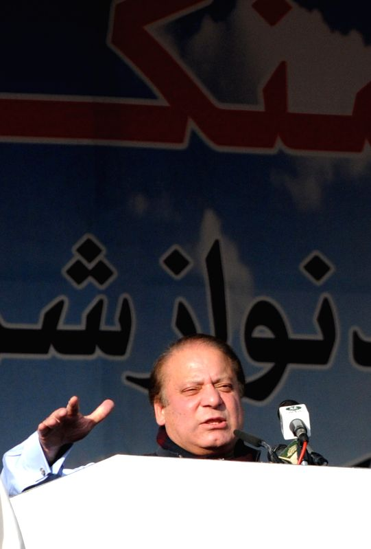 Havelian (Pakistan): Pakistani Prime Minister Nawaz Sharif addresses during a public meeting in northwest Pakistan's Havelian on Nov. 29, 2014. Pakistani Prime Minister Nawaz Sharif addressing a huge