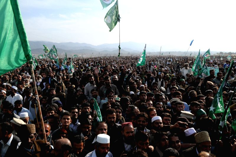 Havelian (Pakistan): Supporters of ruling party Pakistan Muslim League-Nawaz (PML-N) gather during a public meeting in northwest Pakistan's Havelian on Nov. 29, 2014. Pakistani Prime Minister Nawaz ..