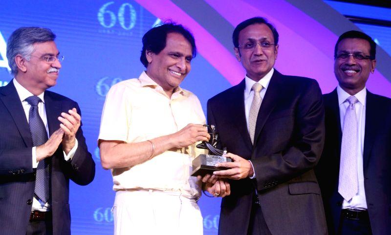 Havells India Chairman and MD Anil Rai Gupta receives Emerging Business er award from Union Railway Minister Suresh Prabhu at the AIMA Awards ceremony in New Delhi, on April 27, 2017. - Suresh Prabhu and Rai Gupta
