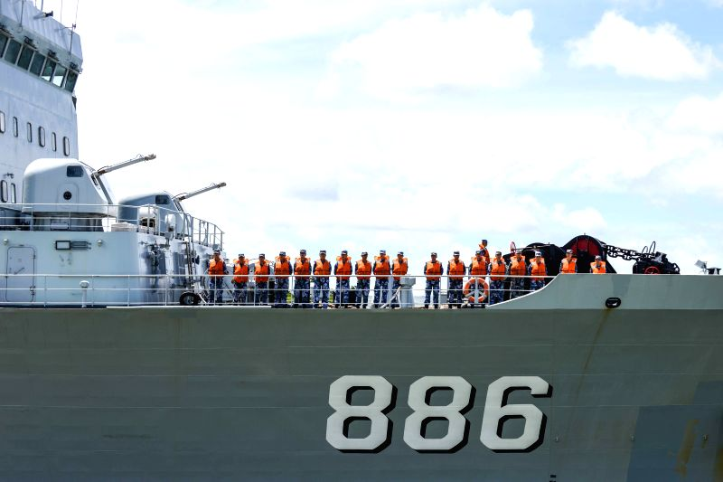 Sailors stand on deck as Chinese navy's supply ship Qiandaohu leaves Pearl Harbor in Hawaii, the United States, July 9, 2014. The Chinese fleet participating in the .