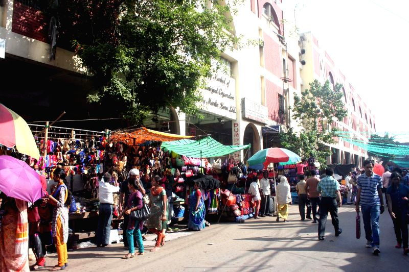 Hawkers busy selling their merchandise outside New Market -S S Hogg Market - in Kolkata, on March 12, 2015.