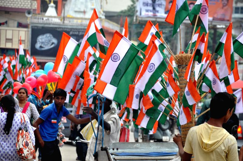 Hawkers sells `tricolors` on Ranchi streets on the eve of Independence Day on Aug 14, 2014.