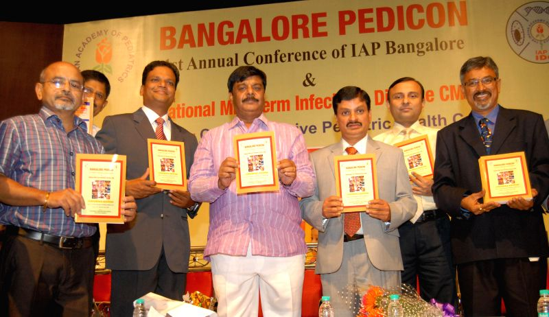 HC Mahadevappa, PWD Minister with Dr Chitkara AJ, Dr Jaydeep Choudhury, Dr Narayanappa D and others seen releasing souvenir, during the 1st Annual Conference of IAP Bangalore and National Mid Term ... - Jaydeep Choudhury
