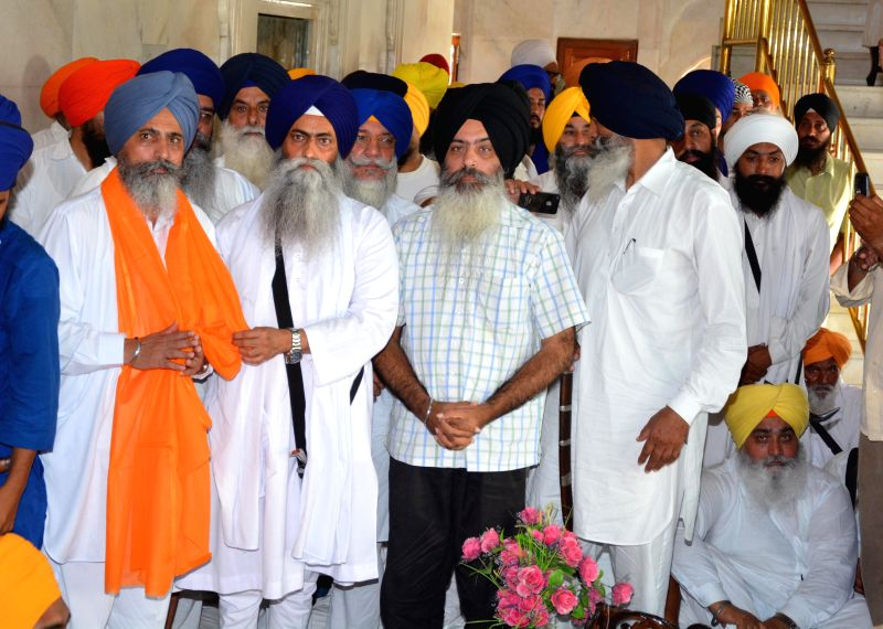 Head granthi of the Golden Temple, Giani Jagtar Singh, Kanwarpal Singh Bittu, Secretary-General of Dal Khalsa and others during the Bhog of Akhand Path organised in the memory of Dilawar Singh at the - Giani Jagtar Singh and Kanwarpal Singh Bittu