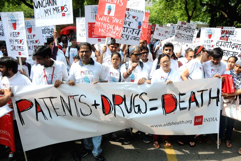 Health activists stage a demonstration in New Delhi on July 31, 2014.