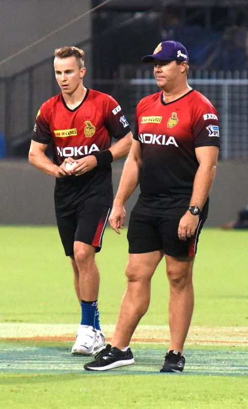 Heath Streak and Tom Curran of Kolkata Knight Riders during a practice session, in Kolkata on April 12, 2018.