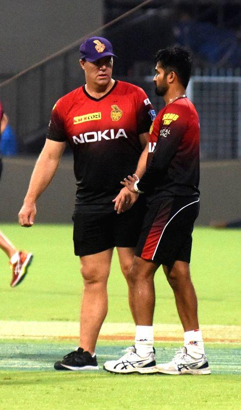 Heath Streak and Vinay Kumar of Kolkata Knight Riders during a practice session, in Kolkata on April 12, 2018. - Vinay Kumar
