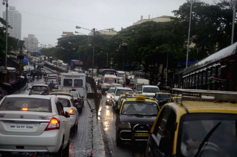 Heavy rain slows-down vehicular traffic in Mumbai on July 11, 2014.