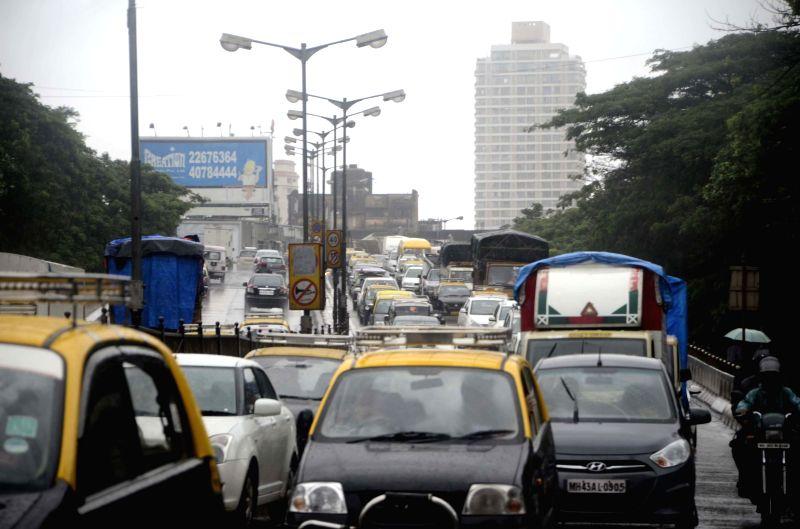 Heavy rain slows-down vehicular traffic in Mumbai on July 11, 2014.