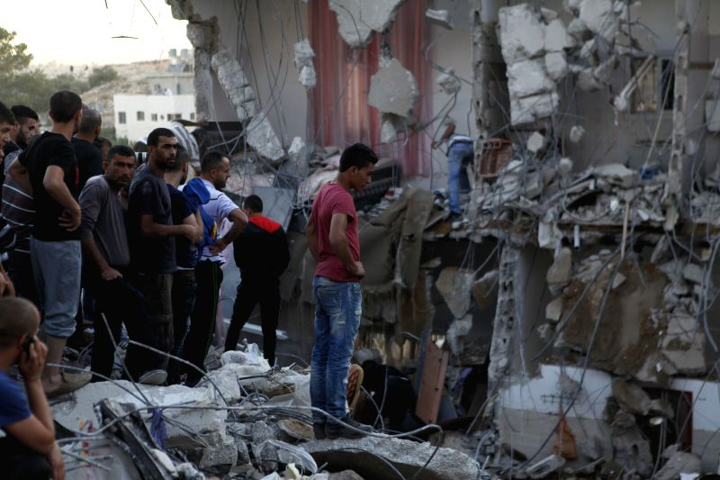 HEBRON, July 27, 2016 - Palestinians inspect a house which was severely damaged during an Israeli raid in the village of Surif, north of Hebron in the West Bank, on July 27, 2016. Israeli security ...
