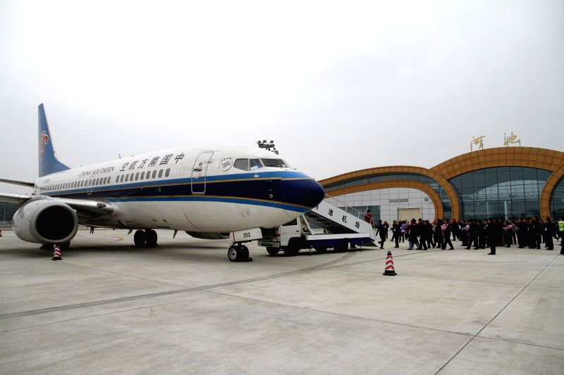 Photo taken on Feb. 12, 2014 shows the plane of the first trial flight at Hechi airport in Heichi, south China's Guangxi Zhuang Autonomous Region. Hechi airport, the .
