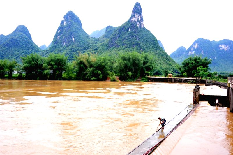HECHI, May 6, 2016 - Flood runs past the Guyu Hydropower Station in Xiaochang'an Township of Luocheng County in Hechi City, south China's Guangxi Zhuang Autonomous Region, May 6, 2016. A torriential ...