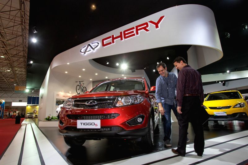 "Visitors look at a Chery ""Tiggo 5"" car in Sao Paulo, Brazil, Nov. 6, 2015. China's Chery Automobile Co., Ltd. has spent more than seven percent of their ..."