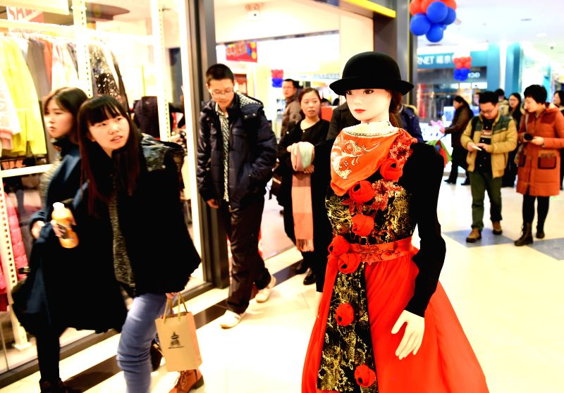 "Shopping robot ""Ke Jia"" debuts at a shopping mall in Hefei, capital of east China's Anhui Province, Jan. 13, 2015. Designed by the University of Science and"