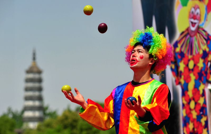 A clown performs during a clown carnival at a park in Hefei, capital of east China's Anhui province, May 1, 2014, the first day of May Day holiday.     Photo: ...