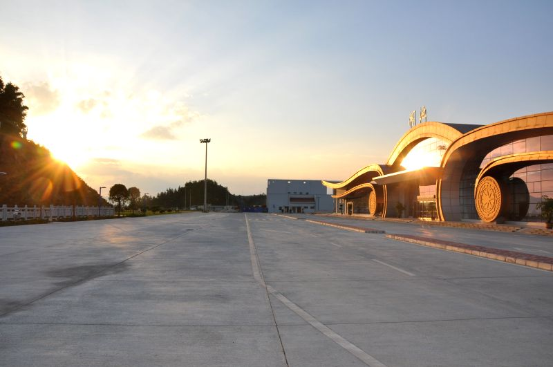 Photo taken on July 10, 2014 shows a terminal building of Heichi airport under the sunset in Heichi, south China's Guangxi Zhuang Autonomous Region. Hechi airport, ..