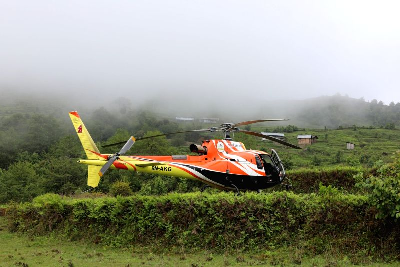 Helicopter parked in a field near Suketar airport in Taplejung district of Nepal.