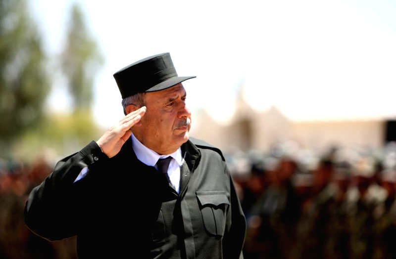 Afghan Minister of Interior Affairs Noor-ul-Haq Ulumi reviews an honor guard during a ceremony at an army camp in Shurabak district of Helmand, Afghanistan, April ...