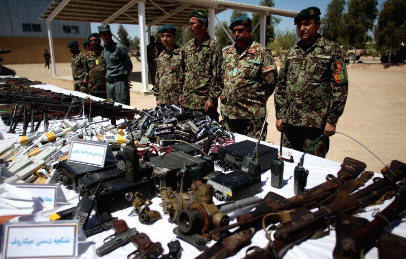 Photo taken on April 8, 2015 shows the ammunition of captured Taliban militants displayed in Shurabak district of Helmand, Afghanistan. Afghan security forces ...