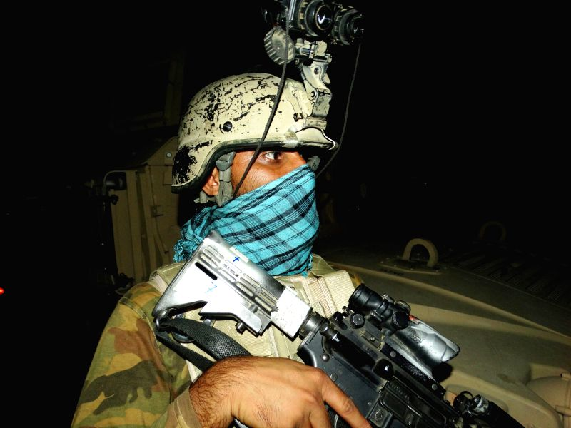 HELMAND, Aug. 3, 2016 - An Afghan special force member takes part in a night military operation against Taliban in Nad Ali district of Helmand province, Afghanistan, Aug. 2, 2016. Some 15 Afghan ...