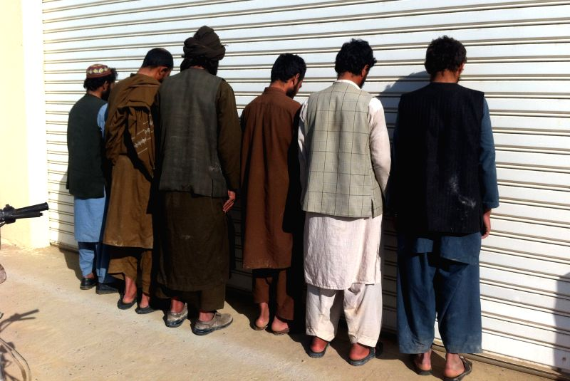 Taliban militants are captured by Afghan security forces in an operation in Helmand province in southern of Afghanistan, March 16, 2015.